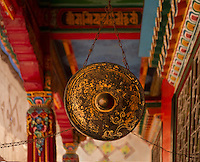 A gong hung from the ceiling at a monastery in the Himalayan foothills of Sikkim, India