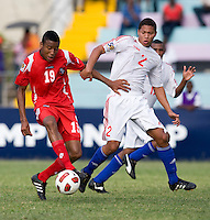 Alejandro Cala (2) of Cuba tries to take the ball away from Alfredo Stephens (19) of Panama during the group stage of the CONCACAF Men's Under 17 Championship at Jarrett Park in Montego Bay, Jamaica. Panama tied Cuba, 0-0.