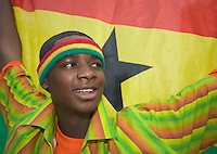 Germany, DEU, Dortmund, 2006-Jun-27: FIFA football world cup (USA: soccer world cup) 2006 in Germany; a young Ghanaian football fan in good mood with his flag before the world cup match Brazil vs. Ghana (3:0).