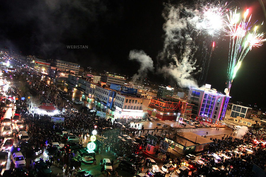 AFGHANISTAN.MAZAR-I-SHARI. 21 March 2010: Fireworks going off in Mazar-i-Sharif during the first night of the Nowruz celebration which usually lasts for two weeks..Thousands of people from all over Afghanistan joined in the revelry, singing and dancing in the streets to welcome New Year 1389..Nowruz marks the beginning of the year and the start of springtime.