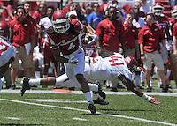 NWA Democrat-Gazette/Michael Woods --04/25/2015--w@NWAMICHAELW... University of Arkansas receiver Keon Hatcher shakes off defender Josh Harris during the 2015 Red-White game Saturday afternoon at Razorback Stadium in Fayetteville.