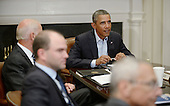 United States President Barack Obama meets with members of the National Security Council in the Roosevelt Room of the White House to receive an update on Iraq, August 18, 2014 in Washington, DC.  <br /> Credit: Olivier Douliery / Pool via CNP