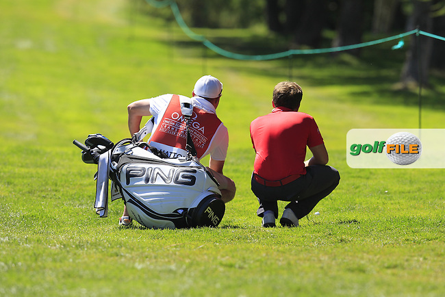 Tyrrell HATTON (ENG) prepares to play his 2nd shot from the rough on the 14th hole during Saturday's Round 3 of the 2014 Omega European Masters held at the Crans Montana Golf Club, Crans-sur-Sierre, Switzerland.: Picture Eoin Clarke, www.golffile.ie: 6th September 2014