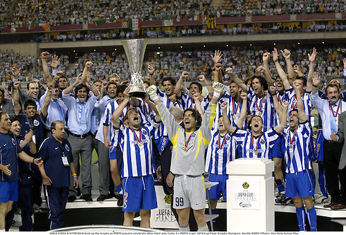 JORGE COSTA &amp; VITOR BAIA hold up the trophy as PORTO players celebrate after their win, Celtic 2 v PORTO 3 aet. UEFA Cup Final, Estadio Olympico, Seville 030521 Photo: Glyn Kirk/Action Plus<br /><br /><br />Soccer Football 2003 celebrate celebrates celebrations celebration joy trophies winner winners portuguese
