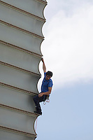 "Austrian climber climbs the Kursaal museum facade for the presesntation of ""Cerro Torre"" film during the 61 San Sebastian Film Festival, in San Sebastian, Spain. September 26, 2013. (ALTERPHOTOS/Victor Blanco)"