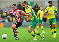 A Lincoln City trial list puts pressure on a Norwich City Sean Raggett<br /> <br /> Photographer Andrew Vaughan/CameraSport<br /> <br /> Football Pre-Season Friendly - Lincoln City v Norwich City - Tuesday 10th July 2018 - Sincil Bank - Lincoln<br /> <br /> World Copyright &copy; 2018 CameraSport. All rights reserved. 43 Linden Ave. Countesthorpe. Leicester. England. LE8 5PG - Tel: +44 (0) 116 277 4147 - admin@camerasport.com - www.camerasport.com