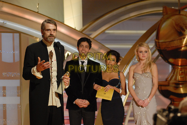 "JEREMY IRONS, ADRIAN GRENIER, EVA LONGORIA & LORRAINE NICHOLSON .Accepts the award for Best Performance By An Actor In A Supporting Role In A Series, Mini Series or Motion Picture Made For Television for ""Elizabeth I"" .Telecast - 64th Annual Golden Globe Awards, Beverly Hills HIlton, Beverly Hills, California, USA..January 15th 2007. .globes half length microphone black suit jacket award.CAP/AW.Please use accompanying story.Supplied by Capital Pictures.© HFPA"" and ""64th Golden Globe Awards"""