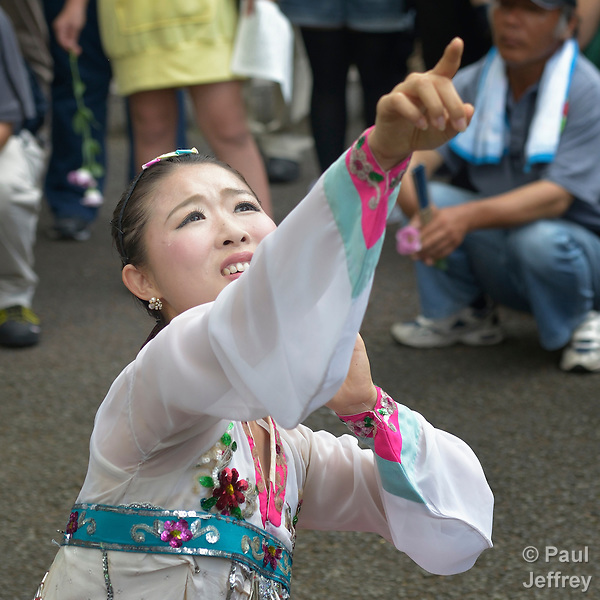 Kim Myosu, a Korean-Japanese dancer, points to horror coming from the sky as she performs during a ceremony in Nagasaki, Japan, on August 9, 2015, commemorating the 70th anniversary of the killing of Korean forced laborers when the United States dropped an atomic bomb on the city. The Koreans had been brought to Japan to work as slaves during the war. The church in Japan has played a key role in addressing Japan's complicity in violence and murder during the war years. The ceremony included the participation of a delegation of pilgrims from the World Council of Churches who each came to Japan to see for themselves the results of the bombings 70 years ago, to listen to survivors and local church leaders, and to recommit themselves to new forms of advocacy for a world free of nuclear weapons.