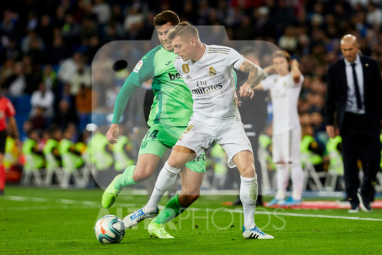 Toni Kroos of Real Madrid and Rivera of CD Leganes during La Liga match between Real Madrid and CD Leganes at Santiago Bernabeu Stadium in Madrid, Spain. October 30, 2019. (ALTERPHOTOS/A. Perez Meca)