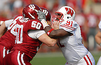 Wisconsin's Jason Chapman goes up against Indiana's John Sandberg, as the Badgers top the Hoosiers 52-17 on Saturday at Memorial Stadium in Bloomington, Indiana