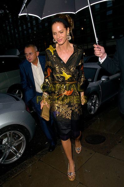 TRINNY WOODALL.The Tatler Summer Party, Home House, London, England..June 27th, 2007.full length black leggings gold yellow orange pattern jacket wedges shoes bracelets silver clutch purse headband umbrella .CAP/CAN.©Can Nguyen/Capital Pictures