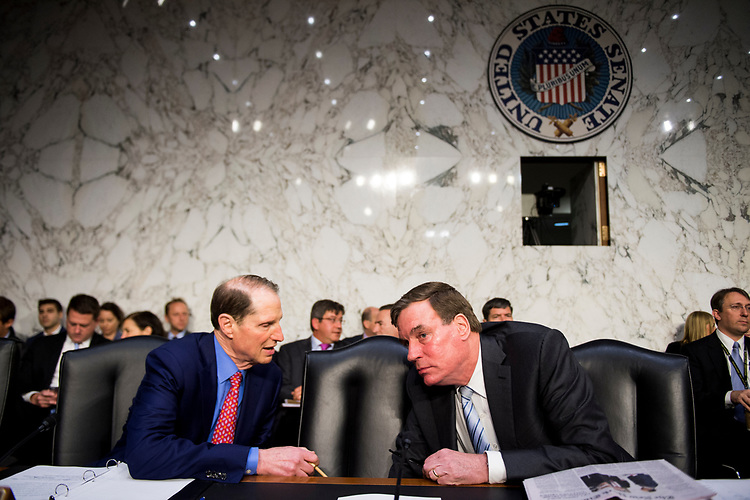 "UNITED STATES - MAY 11: From left, Sen. Ron Wyden, D-Ore., and Sen. Mark Warner, D-Va., talk before the start of the Senate (Select) Intelligence Committee hearing on ""World Wide Threats"" on Thursday, May 11, 2017. (Photo By Bill Clark/CQ Roll Call)"