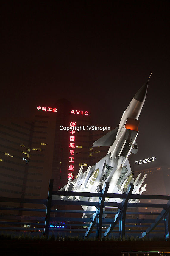 An aircraft is seen in front of the headquarter building of China Aviation Industry Corporation, Beijing, China..