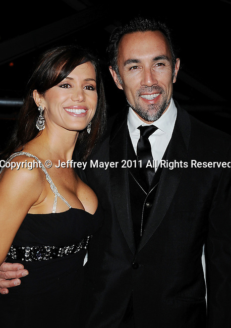 BEVERLY HILLS, CA - January 16: Francesco Quinn and Valentina Castellani Quinn arrive at The Weinstein Company and Relativity Media's 2011 Golden Globe After Party presented by Marie Claire held at BAR 210 - The Beverly Hilton Hotel on January 16, 2011 in Beverly Hills, California.