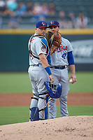 Buffalo Bisons catcher Reese McGuire (7) has a meeting on the mound with starting pitcher Thomas Pannone (47) during the game against the Caballeros de Charlotte at BB&T BallPark on July 23, 2019 in Charlotte, North Carolina. The Bisons defeated the Caballeros 8-1. (Brian Westerholt/Four Seam Images)