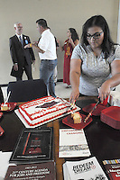 NWA Democrat-Gazette/FLIP PUTTHOFF <br /> Patricia Rodriguez, volunteer with the Urban League of Arkansas, cuts cake for guests after a ribbon-cutting ceremony Friday Sept. 18 2015 recognizing the new Springdale office of the Urban League of Arkansas. The office is in the Center for Nonprofits, 614 E. Emma Ave.