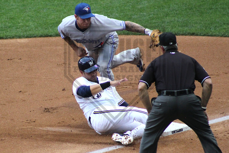 MILWAUKEE - June 2012: Brett Lawrie (13) of the Toronto Blue Jays puts a tag on Aramis Ramirez (16) of the Milwaukee Brewers during a game on June 18, 2012 at Miller Park in Milwaukee, Wisconsin. (Photo by Brad Krause). ..