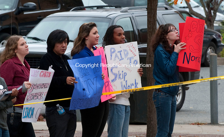 WATERBURY, CT-28 OCTOBER 2012--102812JS08--Supporters for Linda McMahon and Mitt Romney stand across the street from the  Palace Theater in Waterbury on Sunday prior to a rally for Chris Murphy. .Jim Shannon Republican-American