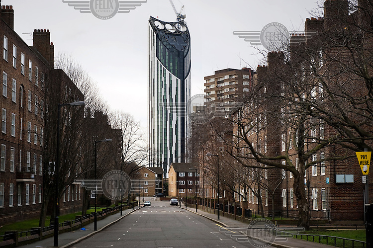 Highrise residential tower, Strata SE1, rises above a red brick housing estate in the London Borough of Southwark. Strata SE1 (Castle House) is a 43 storey tower and at 148 metres is the tallest residential building in London. Its summit features three wind turbines that provide power to the entire building and, if necessary, can be linked to the local grid.
