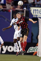 The  Wizard's Shavar Thomas goes up for a header with the MetroStars' John Wolyniec. The Kansas City Wizards were defeated by  the NY/NJ MetroStars to a 1 to 0 at Giant's Stadium, East Rutherford, NJ, on May 30, 2004.