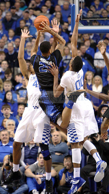 UK freshman forward Trey Lyles (41) and sophomore forward Marcus Lee (00) jump to block a shot by Buffalo junior guard Rodell Wigginton (20) during the first half of the University of Kentucky vs. State University of New York at Buffalo men's basketball game at Rupp Arena in Lexington, Ky., on Sunday, November 16, 2014. UK won 71-52. Photo by Tessa Lighty | Staff