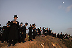 Ultra-Orthodox Jewish men and children pray during a 'Tashlich' ritual along the Mediterranean Sea in Herzliya, central Israel. 'Tashlich' ('to cast away') is a Jewish practice by which believers go to a flowing body of water and symbolically 'throw away' their sins, before the Day of Atonement ('Yom Kippur'), the holiest day in the Jewish calendar.