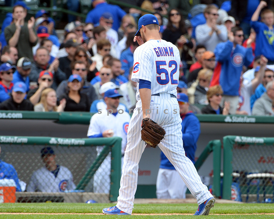 Chicago Cubs Justin Grimm (52) during a game against the New York Mets on May 14, 2015 at Wrigley Field in Chicago, IL. The Cubs beat the Mets 6-5.