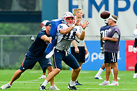 August 3, 2017: New England Patriots wide receivers coach Chad O'Shea hits wide receiver Austin Carr (84) with a training cushion while he is making a catch at the New England Patriots training camp held at Gillette Stadium, in Foxborough, Massachusetts. Eric Canha/CSM