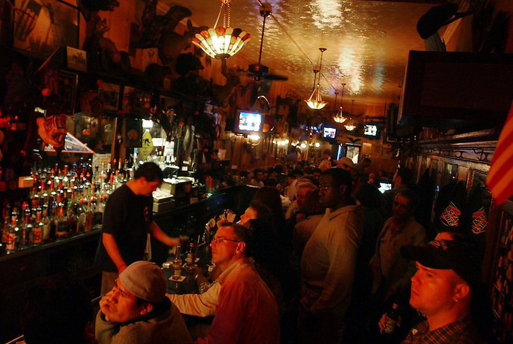 Patrons watch state voting returns during election night 2004 at Tune Inn on Capitol Hill.
