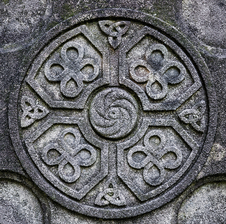 Celtic cross detail with knot symbol designs.