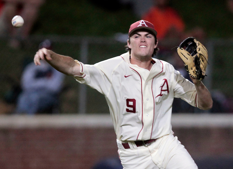 Arkansas outfielder Clark Eagan (9) throws the ball to first base for the out in the sixth inning during an NCAA college baseball regional tournament game against Virginia in Charlottesville, VA., Sunday, June 1, 2014. (Photo/Andrew Shurtleff)