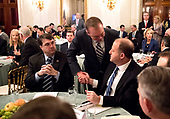 Acting White House Chief of Staff and Director of the Office of Management and Budget (OMB) Mick Mulvaney talks to Governor Jared Polis (Democrat of Colorado) before United States President Donald J. Trump speaks to a group of governors during the 2019 White House Business Session at the White House in Washington, D.C. on February 25, 2019. Trump discusses the group on infrastructure, the opioid epidemic, border security and China trade policy. At left is US Secretary of Veterans Affairs (VA) Robert Wilkie.<br /> Credit: Kevin Dietsch / Pool via CNP