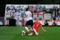 NEWPORT, WALES - AUGUST 31:Toni Duggan of England Women is tackled by Rhiannon Roberts of Wales Women  during the FIFA Women's World Cup Qualifier match between Wales and England at Rodney Parade on August 31, 2018 in Newport, Wales.
