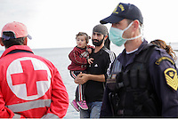 Pictured: A man holding his young daughter disembark to Ierapetra Thursday 27 November 2014<br />