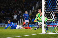 Alex Bass of Portsmouth dives in despair as he is beaten by an own goal scored by Christian Burgess of Portsmouth left during Portsmouth vs Exeter City, Leasing.com Trophy Football at Fratton Park on 18th February 2020