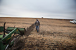 Brett Oelke prepares to dig out a center pivot irrigation system that has become stuck in the mud on his family's 6,000-acre farm outside of Hoxie, Kan., on Friday, Oct. 12, 2012. As historically dry conditions continue, farmers from South Dakota to the Texas panhandle rely on the Ogallala Aquifer, the largest underground aquifer in the United States, to irrigate crops. After decades of use, the falling water level ? accelerated by historic drought conditions over the last two years ? is putting pressure on farmers to ease usage or risk becoming the last generation to grow crops on the land. Farmers like Mitchell Baalman (not pictured) and Brett Oelke are part of a farming community in in Sheridan County, Kansas, an agricultural hub in western Kansas, who have agreed to cut back on water use for crop irrigation so that their children and future generations can continue to farm and sustain themselves on the High Plains.