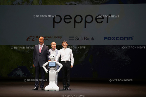 (L to R) Terry Gou chairman & CEO of FOXCONN, Masayoshi Son chairman & CEO of SoftBank, robot Pepper and Jack Ma executive chairman of Alibaba Group pose for the cameras during a press conference to announce that the SoftBank's robot ''Pepper'' can feel as human on June 18, 2015, Tokyo, Japan. Masayoshi Son chairman & CEO of Japanese internet and telecommunications giant SoftBank Corp., announced that its robot Pepper can feel and understand people's emotions and also express itself. Son also said that the first 1000 robots will be on sale to the public for 198,000 JPY (1,604 USD) from Saturday June 20th, and could be available to companies to replace positions such as reception and convenience store staff from the beginning of July. To develop Pepper's skills SoftBank announced an alliance with foreign technology companies FOXCONN and Alibaba Group. (Photo by Rodrigo Reyes Marin/AFLO)