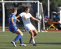 Western New York Flash midfielder Angela Salem (6) controls the ball as Boston Breakers defender Rhian Wilkinson (7) closes. In a National Women's Soccer League (NWSL) match, Boston Breakers (blue) tied Western New York Flash (white), 2-2, at Dilboy Stadium on August 3, 2013.