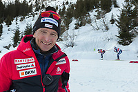 Switzerland. Canton Ticino. Swiss-Cups Campra. Cross Country Skiing. FIS Classic Sprint Race. Hippolyt Kempf is the Cross Country Skiing Chef by Swiss-Ski. He smiles while watching the race. Hippolyt Kempf (born 10 December 1965) is a Swiss Nordic combined skier who competed during the late 1980s and early 1990s. He won a complete set of Olympic medals, earning two of them at the 1988 Winter Olympics in Calgary (gold: 15 km individual, silver: 3 x 10 km team) and the third at the 1994 Winter Olympics in Lillehammer (bronze: 3 x 10 km team). Kempf also earned a 3 x 10 km team silver medal at the 1989 FIS Nordic World Ski Championships in Lahti. Two women competitors schuss down the mountain. Athletes train to achieve endurance, strength, speed, skill and flexibility at different levels of intensity. Swiss-Ski is a branch of Swiss Olympic. The Fédération Internationale de Ski (FIS; English: International Ski Federation) is the world's highest governing body for international winter sports. Founded  on 2 February 1924, it is responsible for the Olympic disciplines of cross-country skiing. The FIS is also responsible for setting the international competition rules. 4.01.2020 © 2020 Didier Ruef