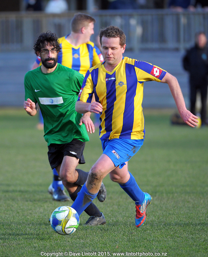 Action from the Horowhenua division one football match between Kapiti Coast United (gold and blue) and Paekakariki United (green and black) at Weka Park, Raumati, New Zealand on Saturday, 11 July 2015. Photo: Dave Lintott / lintottphoto.co.nz