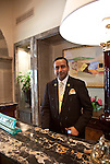 MUMBAI, INDIA - SEPTEMBER 27, 2010: The concierge in the heritage wing reception area at the Taj Mahal Palace and Tower Hotel in Mumbai. The hotel has re-opened after the terror attacks of 2008 destroyed much of the heritage wing. The wing has been renovated and the hotel is once again the shining jewel of Mumbai. pic Graham Crouch