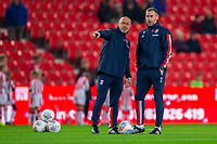 4th November 2019; Bet365 Stadium, Stoke, Staffordshire, England; English Championship Football, Stoke City versus West Bromwich Albion; Stoke City Caretaker Manager Rory Delap and Kevin Russell watch the warm up - Strictly Editorial Use Only. No use with unauthorized audio, video, data, fixture lists, club/league logos or 'live' services. Online in-match use limited to 120 images, no video emulation. No use in betting, games or single club/league/player publications