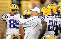 Sept. 5, 2009; Seattle, WA, USA; LSU Tigers head coach Les Miles talks with his players prior to the game against the Washington Huskies at Husky Stadium. Mandatory Credit: Mark J. Rebilas-