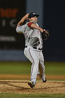 Greenville Drive pitcher Mike Adams #33 delivers a pitch during a game against the  Asheville Tourists at McCormick Field on May 17, 2014 in Asheville, North Carolina. The Tourists defeated the Drive 14-6. (Tony Farlow/Four Seam Images)
