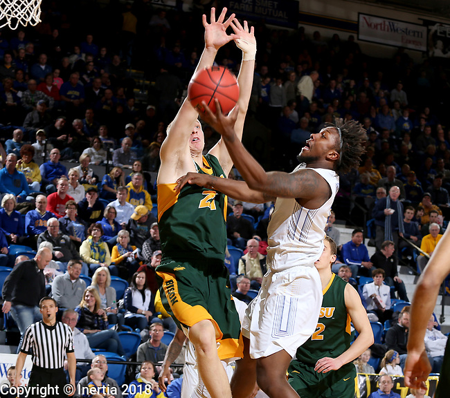 BROOKINGS, SD - FEBRUARY 1: David Jenkins Jr. #5 from South Dakota State University lays the ball up past A.J. Jacobson #21 from North Dakota State University during their game Thursday at Frost Arena in Brookings. (Photo by Dave Eggen/Inertia)