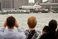 People watch the Space Shuttle Enterprise when it makes its way up by Hudson River to be placed at the Intrepid Sea, Air and Space Museum in New York, June 6, 2012.  Photo by Eduardo Munoz Alvarez / VIEW..