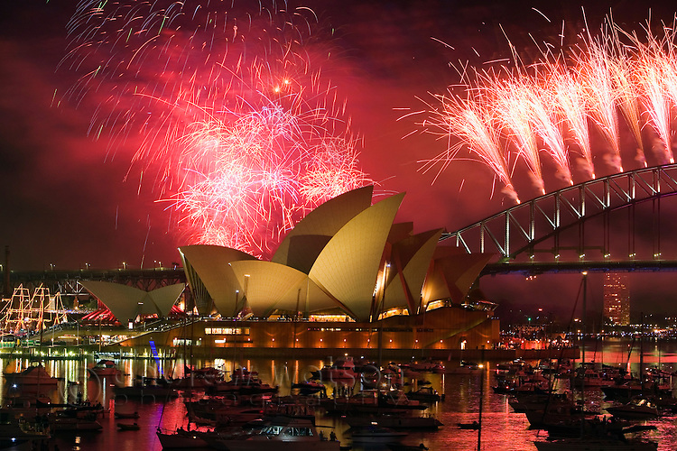 New Year's Eve fireworks over the Opera House and Harbour bridge, Sydney, New South Wales, Australia