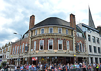 July 21, 2012: View of the crowd gathered at the intersection of Albion road and Church Street to watch Olympic Torch Relay in the town of Stoke Newington, London, England.
