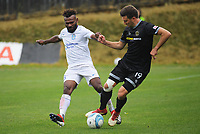 Ross Allen (right) controls the ball under pressure from Joses Nawo during the 2019 OFC Champions League quarter final football match between Team Wellington and Henderson Eels at David Farrington Park in Wellington on Sunday, 7 April 2019. Photo: Dave Lintott / lintottphoto.co.nz