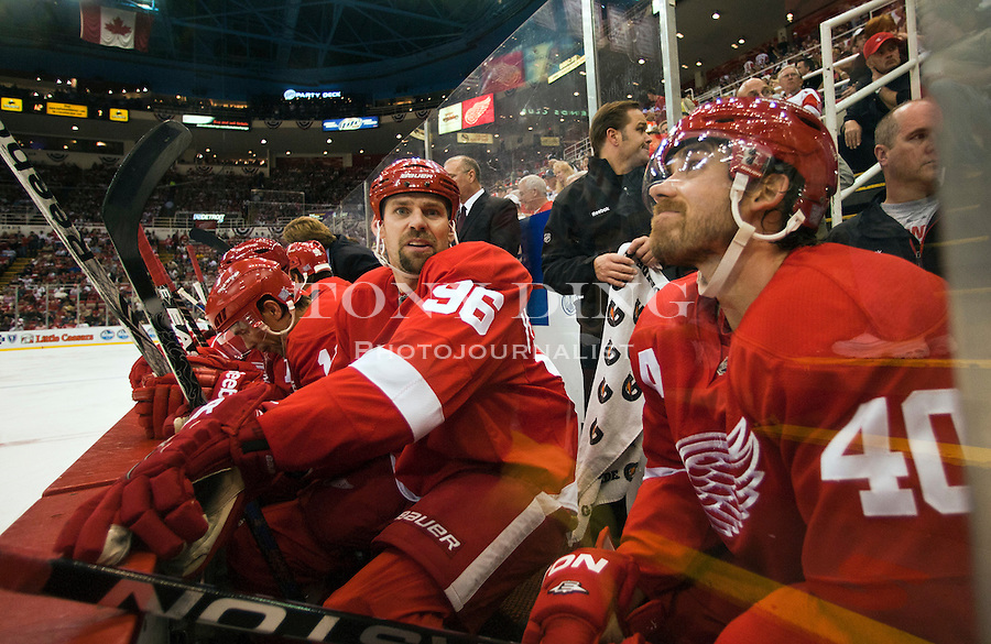 8 October 2010: Detroit Red Wings forward Tomas Holmstrom (96) sneers at the camera sitting on the bench with forward Henrik Zetterberg (40), in the second period of the Anaheim Ducks at Detroit Red Wings NHL hockey game, at Joe Louis Arena, in Detroit, MI...***** Editorial Use Only *****